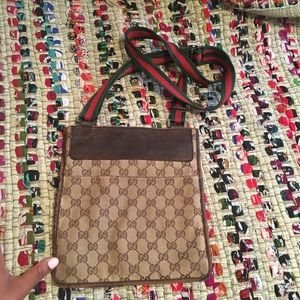 4 pocket Gucci crossbody bag